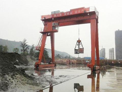 Продать кран козловой грейферный в Китае